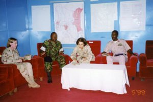 "Discussing joint Kenyan and American military objectives. (My fatigues came as a gift from a Marine general who decided I needed to look the part of a ""field commander."" 1997"