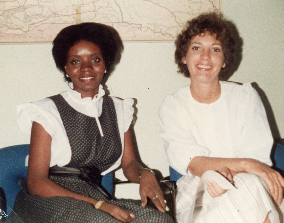 Prudence sitting next to a colleague in the Shippings & Customs Dept in Senegal, 1993